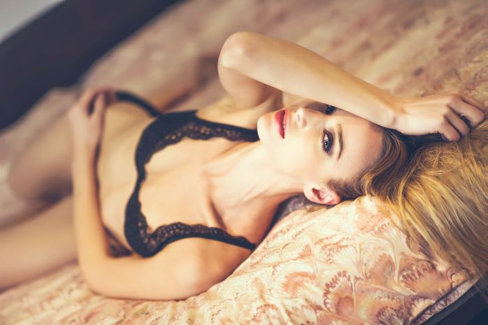 Invercargill hot blonde lying on the bed waiting for you