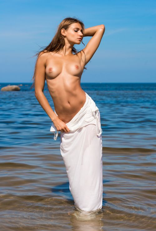 girl undressing on the beach