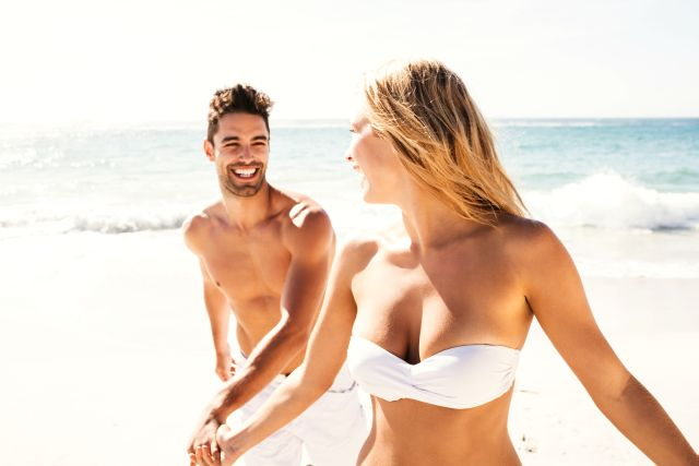 sexy confident lady in the beach with the guy she likes