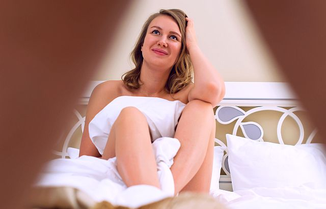 lady in bed understanding why he has a limp dick