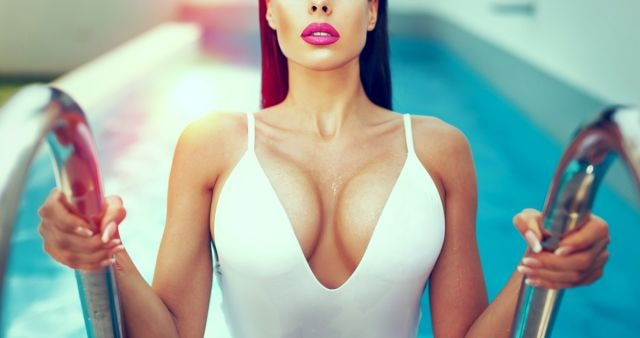 hot woman coming out from the swimming pool