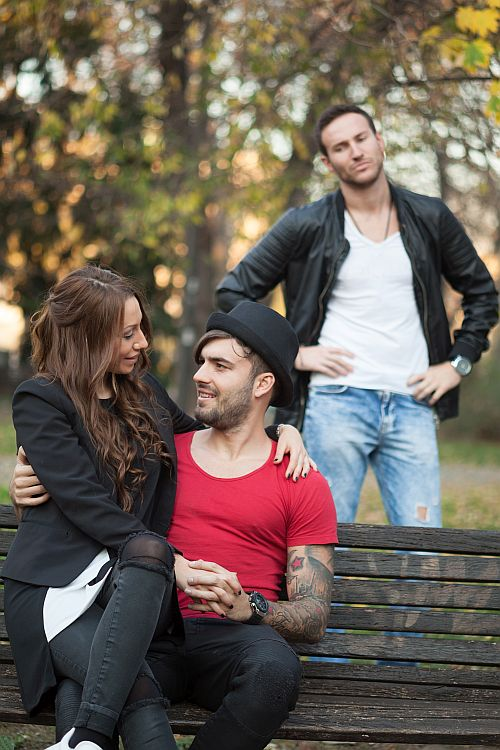 confident brunette flirting with gay man