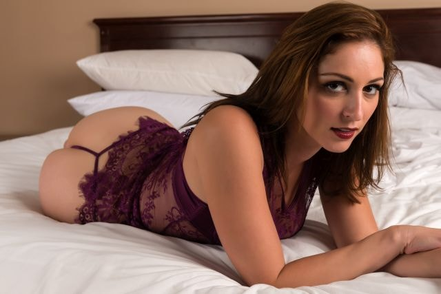 Seductive brunette in purple lingerie