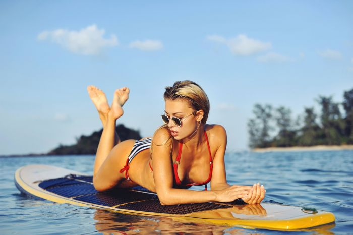 Sexy Australian woman on a surfboard