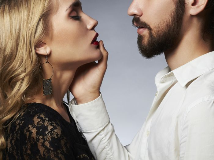 Bearded man with beautiful woman about to make out