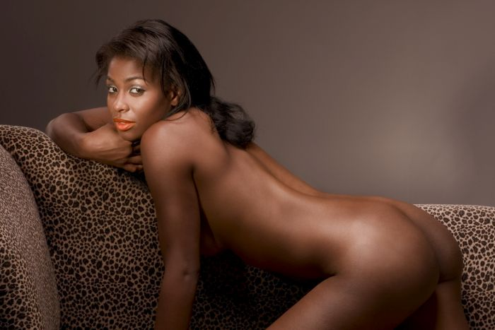 Naked black woman on a sofa