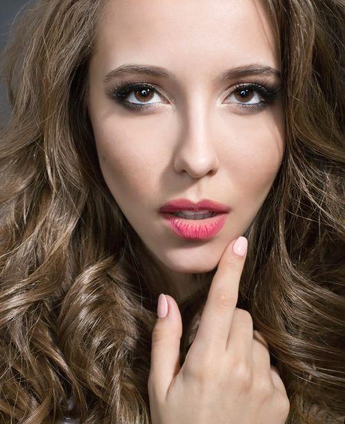 Beautiful woman touching her lips