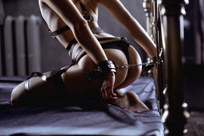 naked girl tied up on the bed