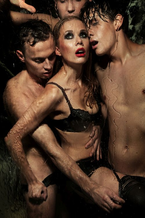 wet woman surrounded by men