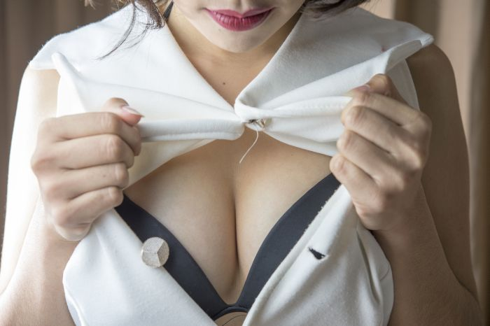 Japanese girl showing her big breasts