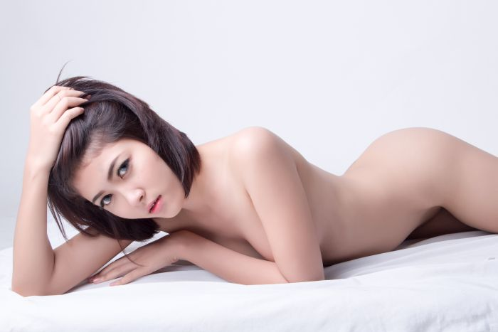 Sexy Chinese girl lying in bed