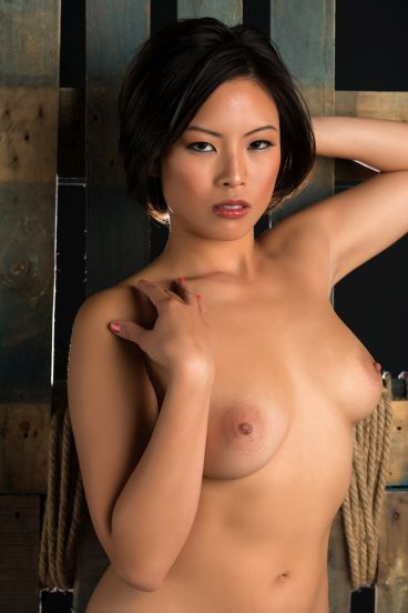 Naked Chinese girl with beautiful breasts