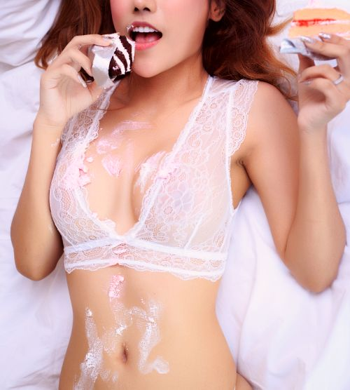 Sexy girl in the middle of a cream pie