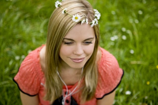 Beautiful blond woman with a daisy chain in her hair