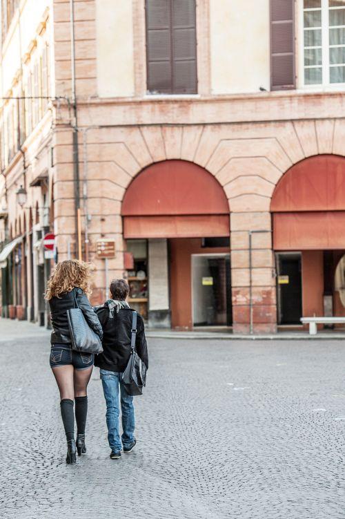 Short man with girlfriend walking holding hands