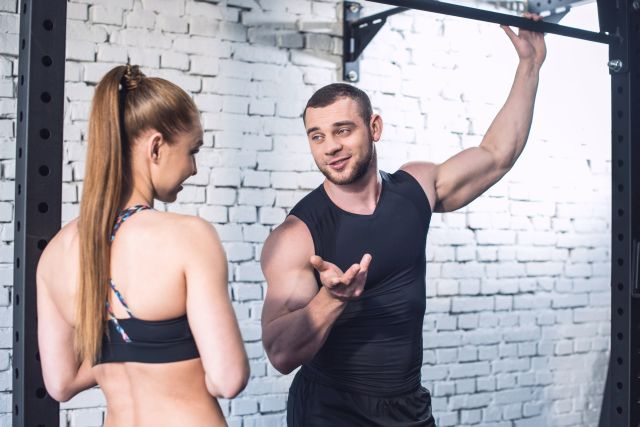 muscular man trying to impress a lady