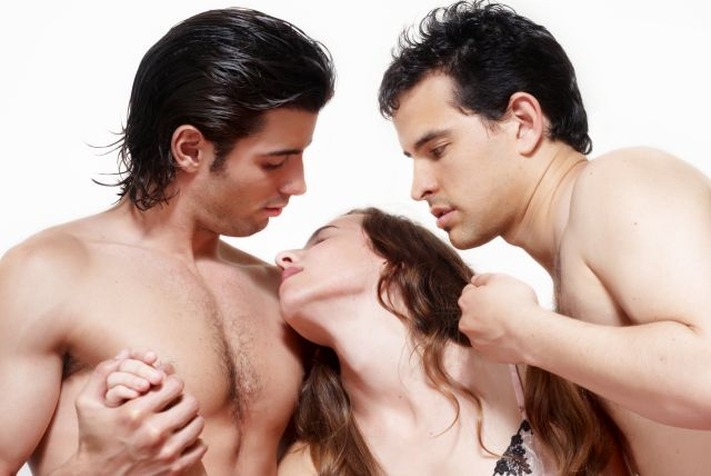 Two men and a woman foreplaying before double penetration