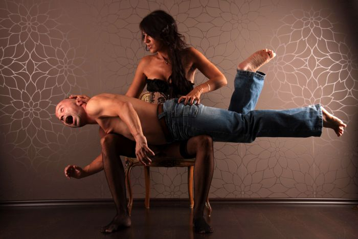 woman spanking her man over her knees