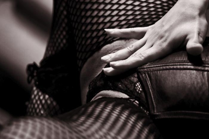 girl touching inbetween her legs
