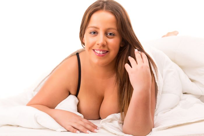 Plus-sized woman relaxing on bed