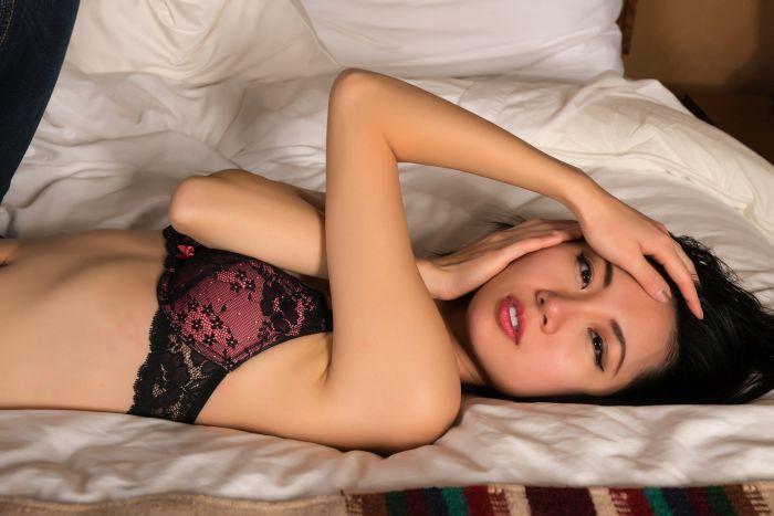 Naked Filipina lying on bed