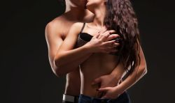 male putting his hands between her legs