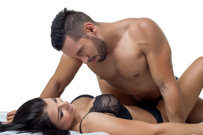 bearded man loking at beautiful brunette woman in black lingerie