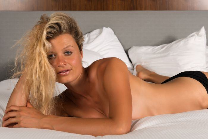 Hot German girl half naked on bed