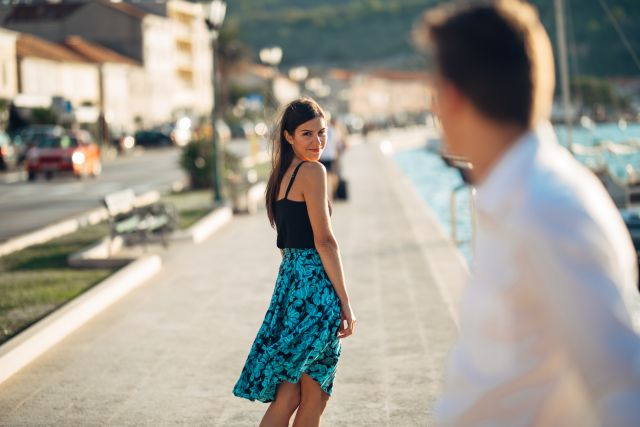 man looking after attractive woman