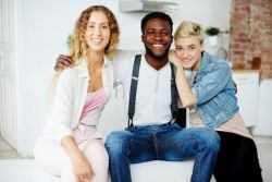 Young polyamorous couple with another woman