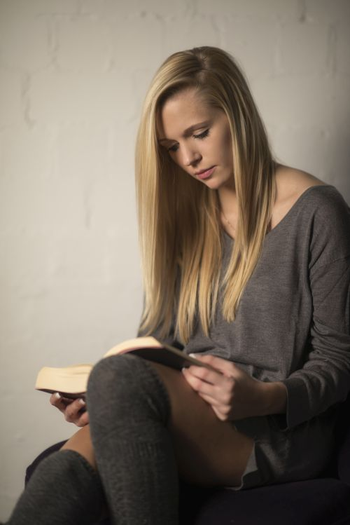 beautiful blonde reading a book