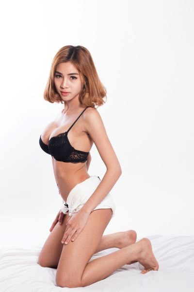 Naked Japanese Girl posing on a Chair