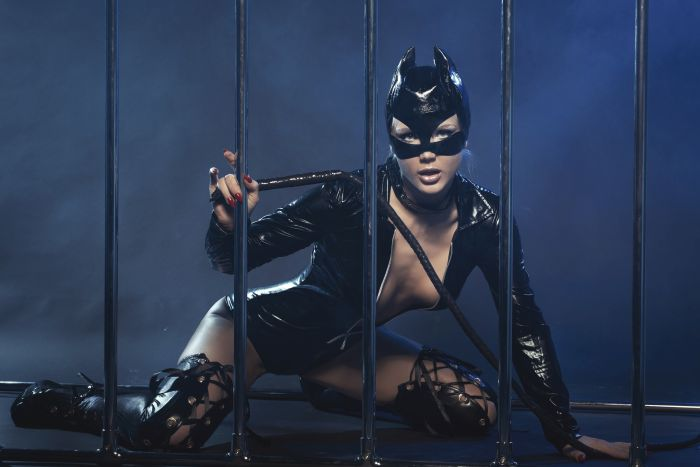 sexy girl in latex cat-suit with a whip