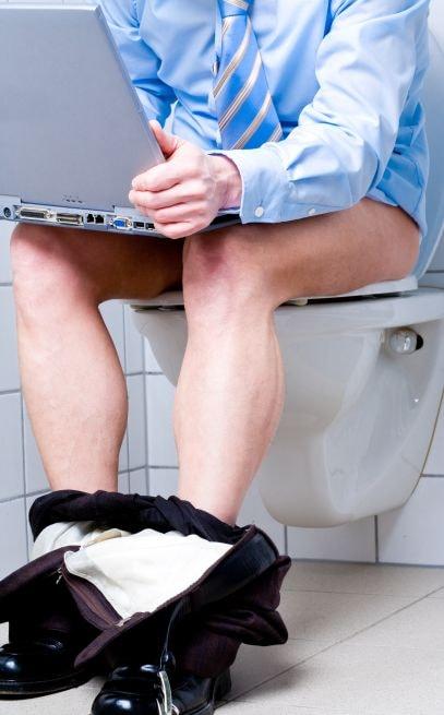 businessman masturbating in the office bathroom