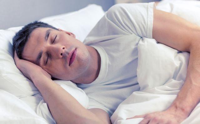 man sleeping having erotic dreams