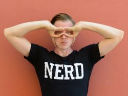 Handome man wearing a nerd t-shirt