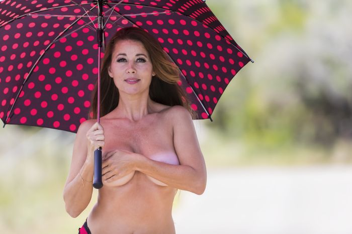 Kiwi Milf playful with umbrella