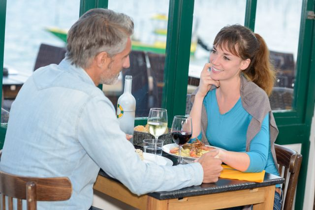 Young woman on a date with an older man