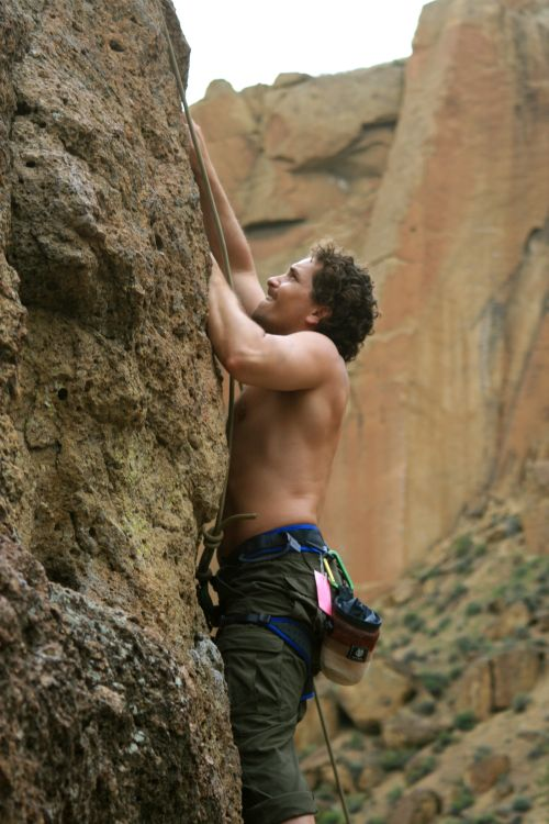 man doing rock climbing