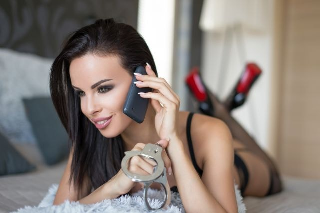 Sexy babe enjoying a bondage roleplay over the phone