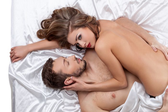 Beautiful couple naked in bed