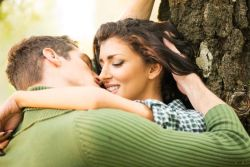 Couple making out in the park