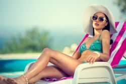 rich girl lying at the pool