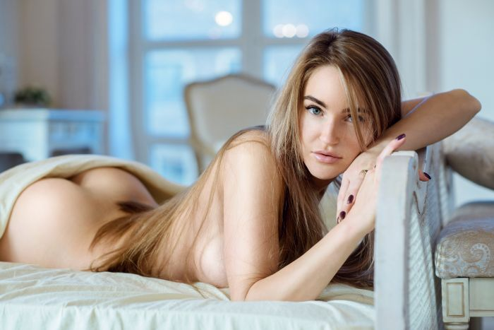 Beautiful nude sexy girl in innocent pose