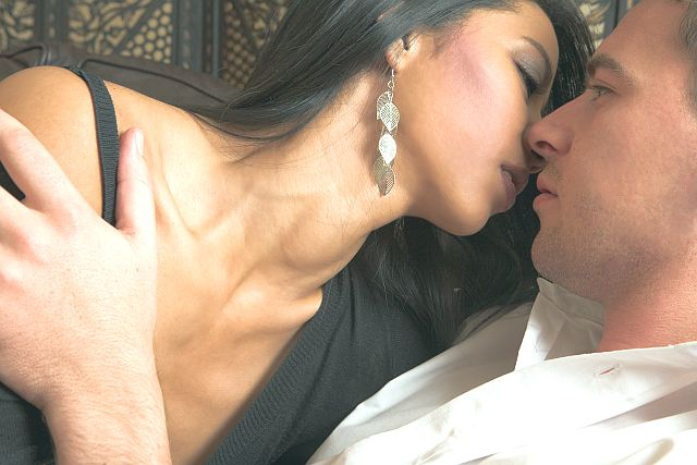 hot woman kising tenderly her partner