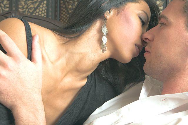 hot woman kising tenderly her partner