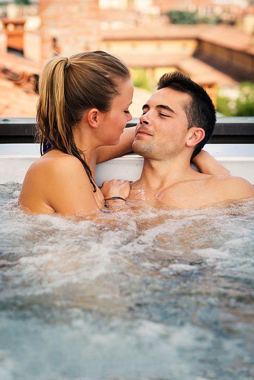 couple in bath getting closer