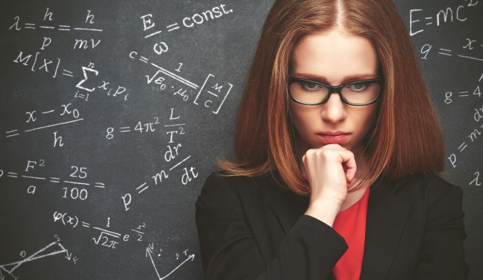 An attractive woman contemplates a science problem