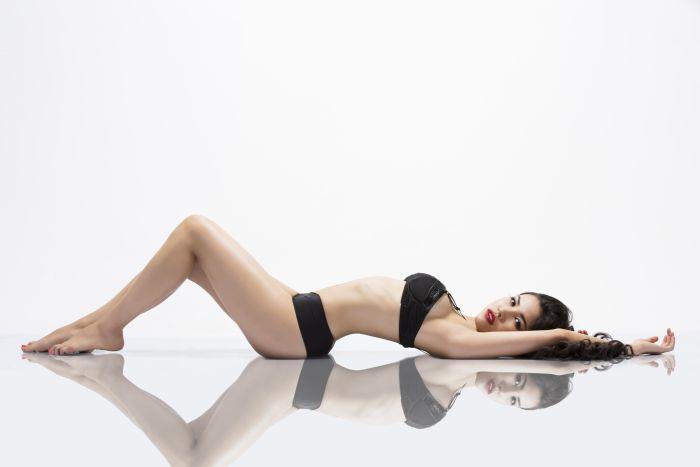 Hot Girl in long black hair on the floor