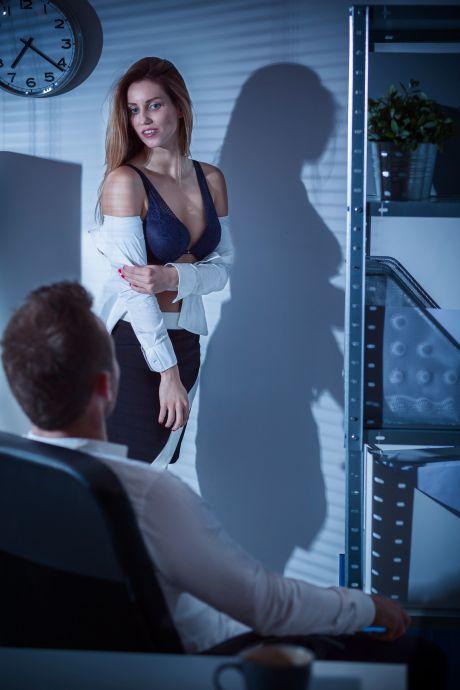 woman seducing man at work